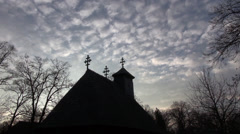 Silhouette of Christian church, against the sky, sunset, dramatic sky, zoom in Stock Footage