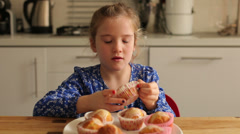 Baking cupcakes eating the cupcake Stock Footage