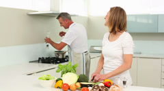 Mature happy couple making dinner together Stock Footage