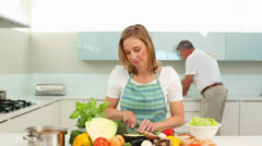Mature couple making dinner together Stock Footage