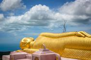 Stock Photo of Buddha sculpture lying