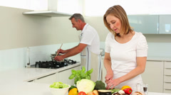Mature happy couple making healthy dinner together Stock Footage