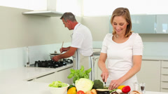 Mature smiling couple making healthy dinner together Stock Footage