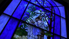 Blue stained glass window - stock footage