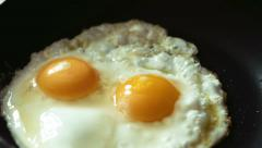 Cooking fried eggs timelapse Stock Footage