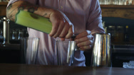 Stock Video Footage of Bar Tender pours a drink