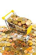 Shopping cart with coins Stock Photos