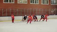 Players of men's junior ice hokey team during training Stock Footage