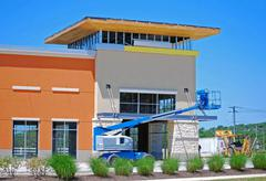 Stock Photo of new construction with boom lift