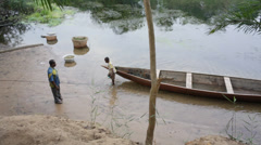 Stock Video Footage of A young man in the volta river in Ghana in his canoe