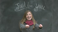 "Stock Video Footage of Cute Girl Dances Under A Chalkboard ""Just Be You"" Sign"
