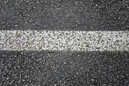 Stock Photo of grungy asphalt street stripe