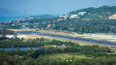 Plane is going to land at the airport of a tropical island Samui Stock Footage