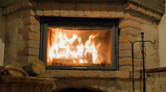 Bright and hectic flames crackle inside fireplace - stock footage