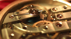 Old golden clock mechanism working, closeup shot with soft focus Stock Footage