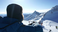 Woman in the mountains looking at beautiful view in ski resort, close up HD Stock Footage