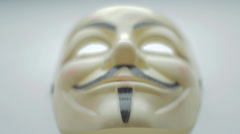 Anonymous mask with smooth pan Stock Footage