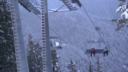 Stock Video Footage of Skiers on chairlift ready to jump off and ride