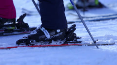 SKIIERS IN LINE FOR THE LIFT Stock Footage
