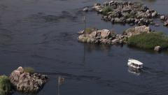 A boat on the Nile river, opposite direction, Aswan, Egypt Stock Footage