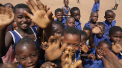 School children hailing out of the school in Ghana, greater Accra region. - stock footage