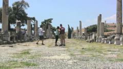 Turkey Asklepion promenade ruins tourists zoom out Stock Footage