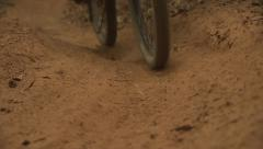 Slow Motion Mountain Bike Wheels With Dust - stock footage