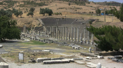 Turkey Asklepion ruins arena, columns w amphitheater behind Stock Footage
