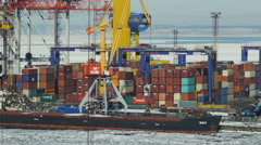 Container terminal in the winter season with a frozen sea on a background Stock Footage