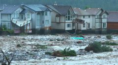 Raging flood waters threaten homes  h 01 Stock Footage