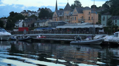 Boats in Harbor and view on the village Stock Footage