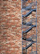 Stock Photo of fire escape on old brick wall