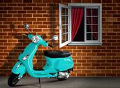 Stock Photo of scooter with brick wall background