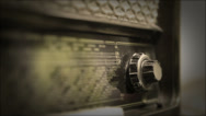 Stock Video Footage of Very old Retro Radio, Hand Changing Stations - Sepia Version