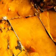 Closeup of golden amber as background or texture. resin gem. Stock Photos
