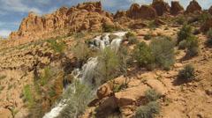 Slow Panning Shot of Waterfall In Southern Utah Desert Slow Motion Stock Footage