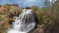 Beautiful Panning Shot of Flowing Waterfall In Southern Utah Desert Stock Footage