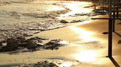 A man walking on the beach Stock Footage