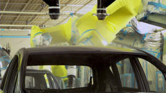 Robots are painting in automobile factory Stock Footage