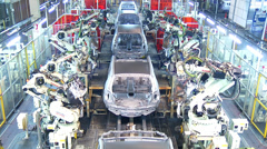 Stock Video Footage of Robots in Automobile Factory