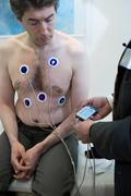 man with ecg holter - stock photo