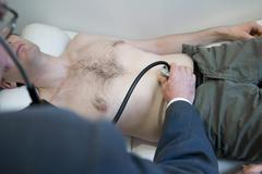 abdomen auscultation - stock photo