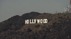 Zooming out of the famous Hollywood sign in Los Angeles, California Stock Footage