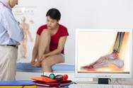 Stock Photo of podiatry consultation for woman