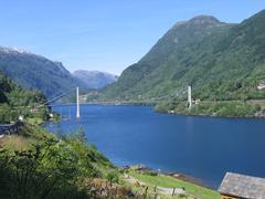 Lake with Fijksund bridge (1937) in Norway - stock photo