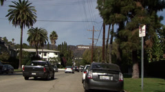 Zooming out of the Hollywood sign to a street in Los Angeles, California - stock footage
