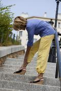 Ankle pain elderly person Stock Photos