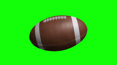 American Football Spinning on green screen Stock Footage
