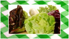Vegetables edited sequence over green tablecloth background Stock Footage