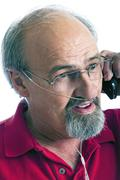 Man Wearing A Cannula For Oxygen Talking On The Phone - stock photo